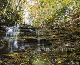 Waterfall in the forest in autumn in Italy.