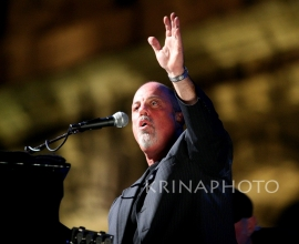 Bryan Adamns and Billy Joel in the concert.
