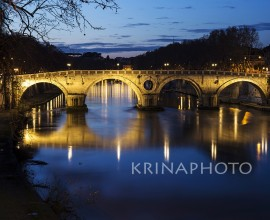 Night landscape of the Tiber river and Sisto bridge in Rome.