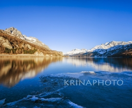 Winter landscape on Lake Sils in Switzerland.