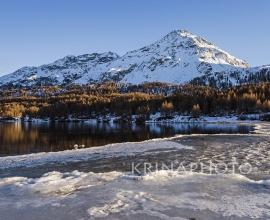 Winter landscape on Lake Sils in Switzerland.